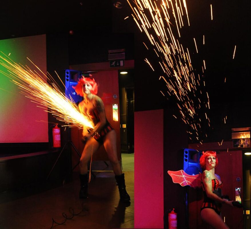Halloween performer creating sparks with an angle grinder Brighton