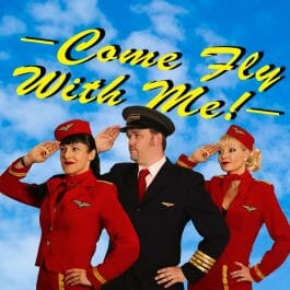 The cast of the 'Come Fly With Me' show. A pilot and two stewardesses saluting in front of a blue sky background.