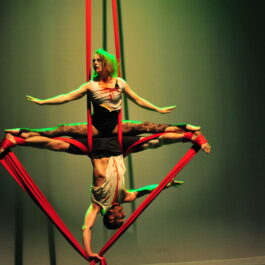 Brighton aerial silks male female duo in dramatic mirror image hold