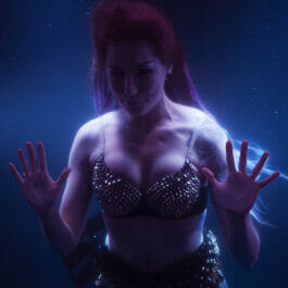 Mermaid Performer In Water Tank