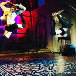 two female dancers leaping at show in Brighton