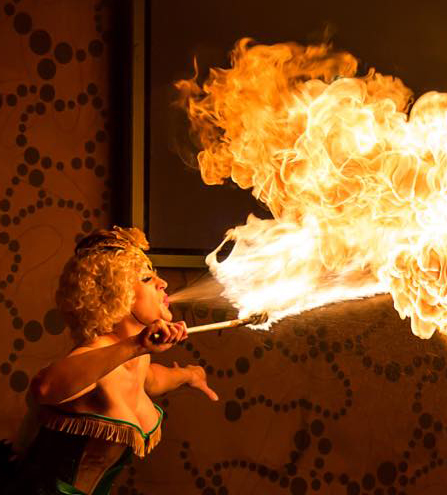 close up shot of fire breather creating a ball of fire illustrating the best bonfire night party entertainment ideas