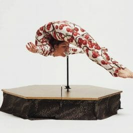 contortionist in floral bodysuit performs the marinelli bend a favourite for circus theme parties
