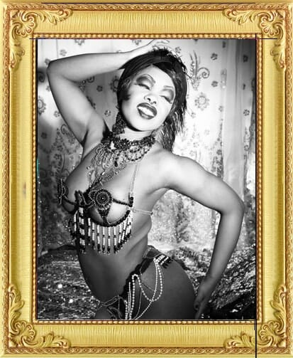 black and white glamour image of Burlesque performer for hire and performing in shows in London and Brighton with beaded bikini and jewellery
