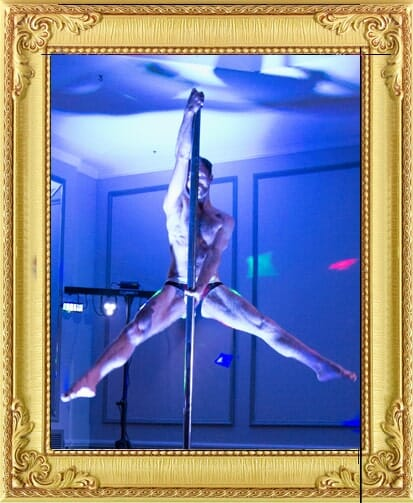 Burlesque performers for hire include our male pole dance. He holds muscular pose on pole in cabaret shows performing in shows in London and Brighton