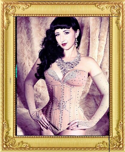 beautiful burlesque performer for hire poses in costume jewellery and vintage jewelled corset performing in shows in London and Brighton