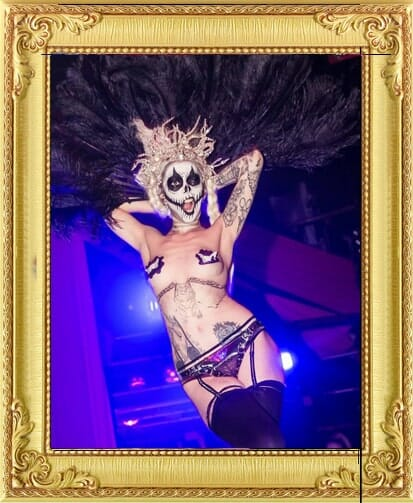 alternative burlesque performers for hire with skull face-paint powdered wig and tattoos at cabaret shows in London and Brighton