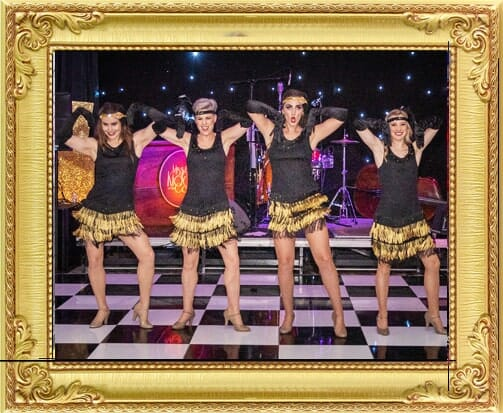 Some of our cabaret performers for hire in Brighton and London, Charleston dancers dancing at Gatsby themed corporate event in Brighton in black and gold costumes