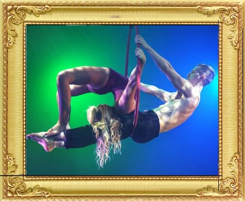 One of our circus acts for hire in London and Brighton, male and female aerialist circus act perform a high flying routine at a circus in London