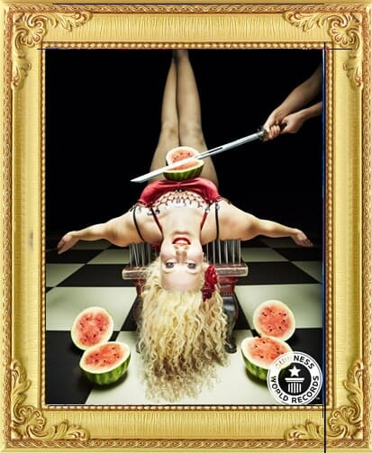 Freak show style circus acts for hire in London and Brighton. A beautiful lady lies on a bed of nails with a melon on her being cut by a sword in London show