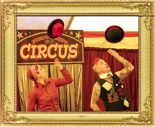 Cute circus acts for hire circus in London and Brighton, this duo in crazy clown costume juggle hats in big top
