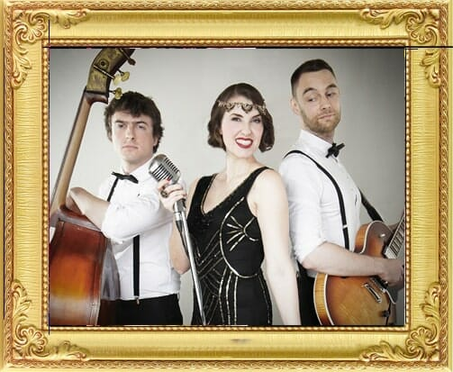 Corporate party entertainment in London and Brighton, vintage band as corporate party entertainment in bowtie and braces with guitar and double bass and singer in a 1920s dress