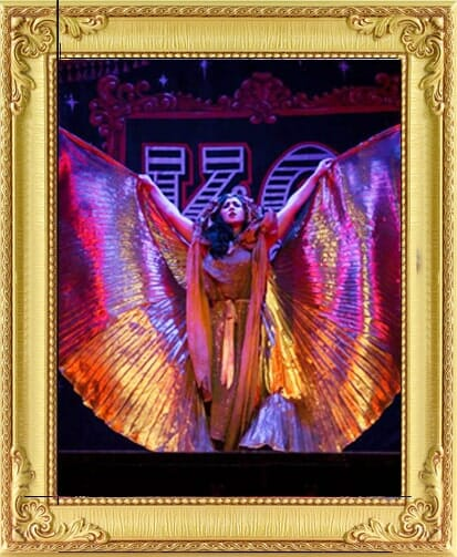 Corporate party entertainment in London and Brighton, dancer as corporate party entertainment with giant gold isis wings at event in London