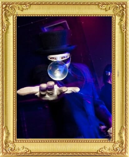 crystal ball manipulator in a mask makes a ball float for bespoke entertainment in London and Brighton