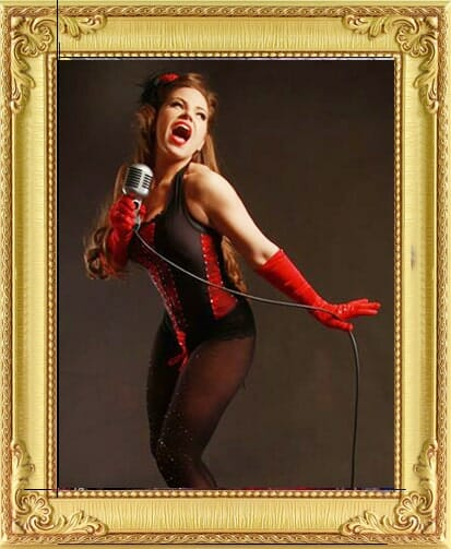 One of our cabaret performers for hire in Brighton and London, vintage female cabaret singer performs in corset and long gloves with vintage mic at theme event