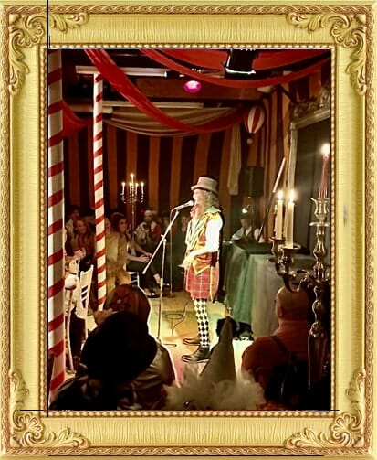 Magician for hire in London and Brighton performs on stage in vintage costume at Brighton circus themed event