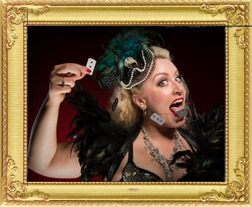 pretty victorian female magician for hire in London and Brighton swallows razorblades at London theme show
