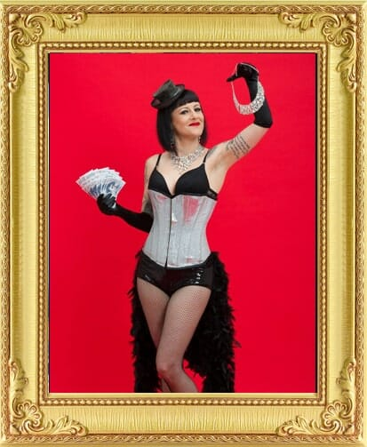 burlesque performer in silver corset holding money and diamonds at an event with our full service event management in London and Brighton.
