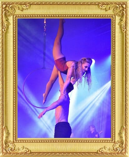 male and female aerial hoop act on stage at the Greatest Showman event with full service event management in London and Brighton.