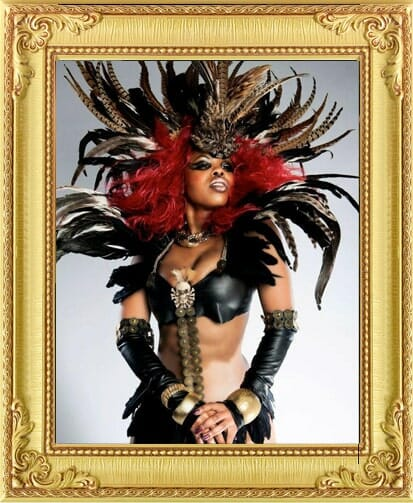 Performers for Hire Brighton & London, warrior style Burlesque dance performer in costume with red hair at show in Brighton
