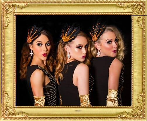 Some of our cabaret performers for hire in Brighton and London, a trio of cute vintage dancers in black and gold costumes at London corporate event