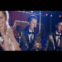 big band musicians in vintage gold suits perform in London ballroom