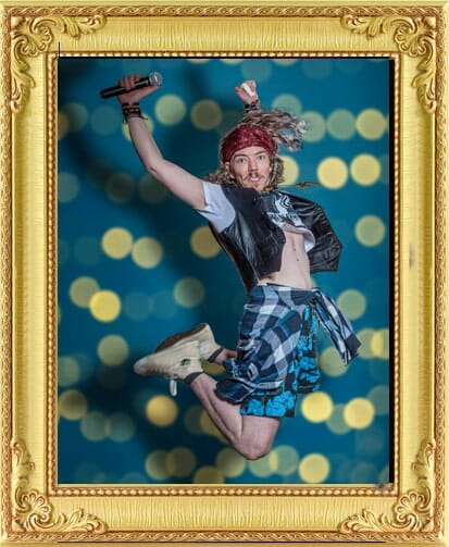 1990's singer and host from our event management & entertainment agency jumps in the air in grunge style outfit