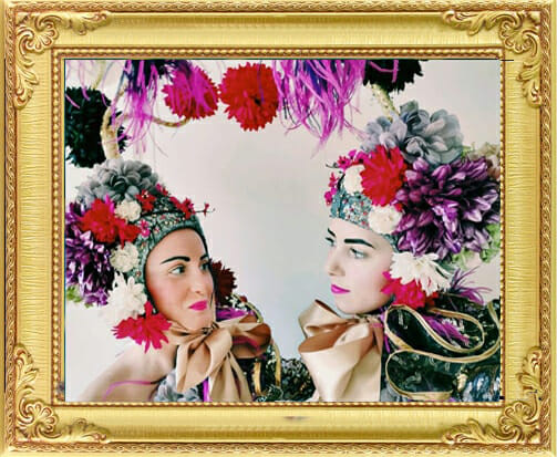 bespoke entertainment in London and Brighton, performers in floral costumes with big multi-colour flower head-pieces