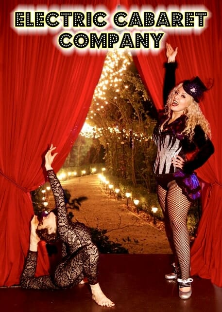 Ring mistress and contortionist stand in front of open red curtain showing a magically lit pathway ahead, illustrating the best outdoor party ideas