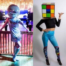 disco ball head dancer and rubiks cube head dancer pose in their custom head costumes