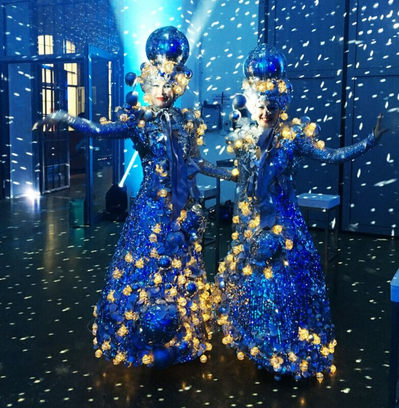 Glitter ball Christmas decoration costumed walkabout act