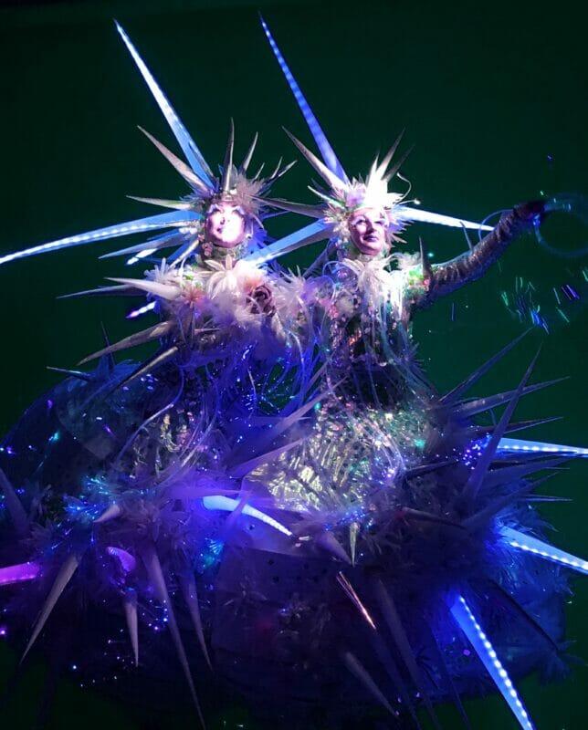 Christmas ice queen stilt-walkers in spiked iridescent costume