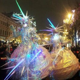 Ice queens stilt walking in a Christmas street parade in beautiful ice spiked costume