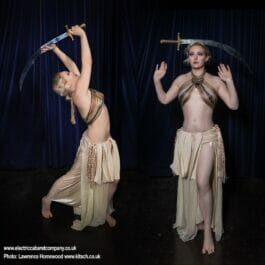 sword balancing performer in Egyptian dress for hire in London and Brighton