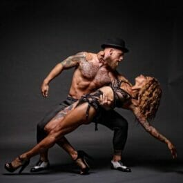 muscular, tattooed male and female dancers hold a dramatic pose in Brighton